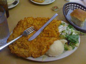 BIG chicken fried steak with the gravy underneathe.