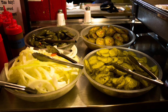 A traditional BBQ dinner is not complete without pickles and onions.